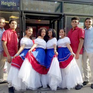 Members of the Alianza's El Conjúnto Folklórico Ensemble prepare to perform | Miembros del Grupo El ConjUnto Folklórico de la Alianza se preparan para actuar.